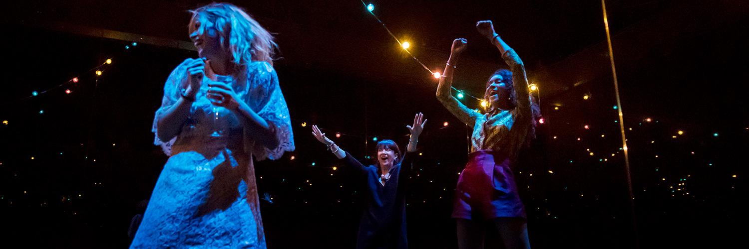 Production photo from Yerma by Johan Persson of the cast partying in the festival scene.